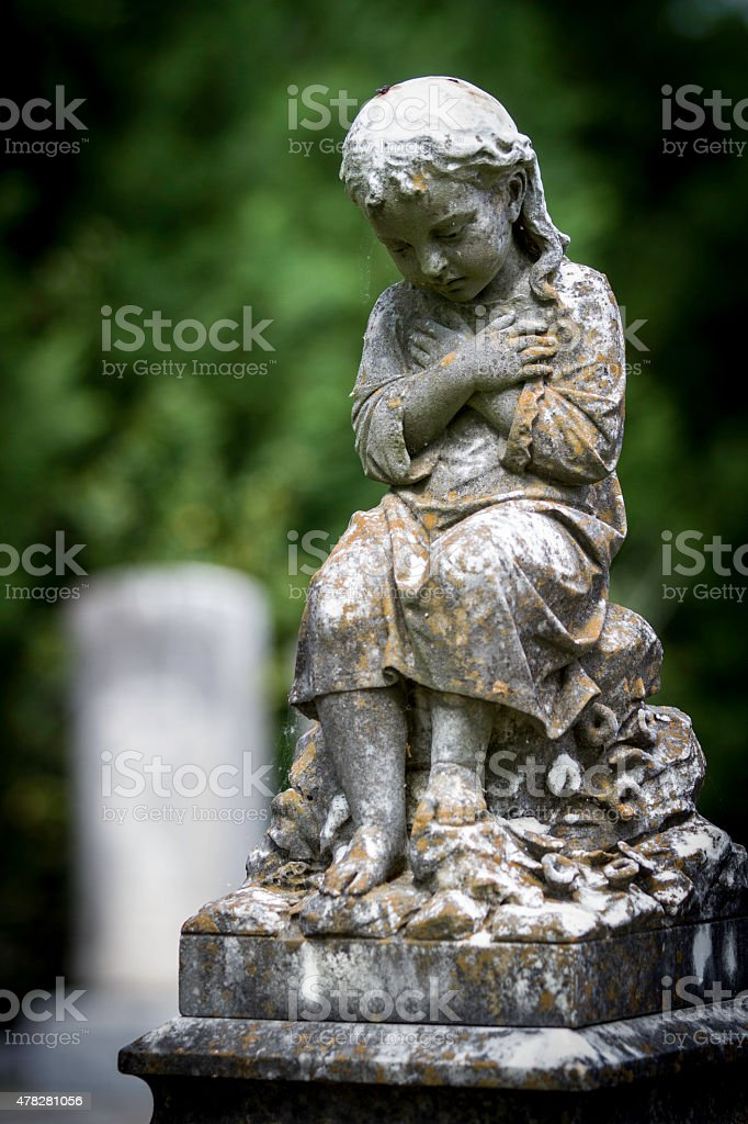Statue of Girl in Cemetery stock photo