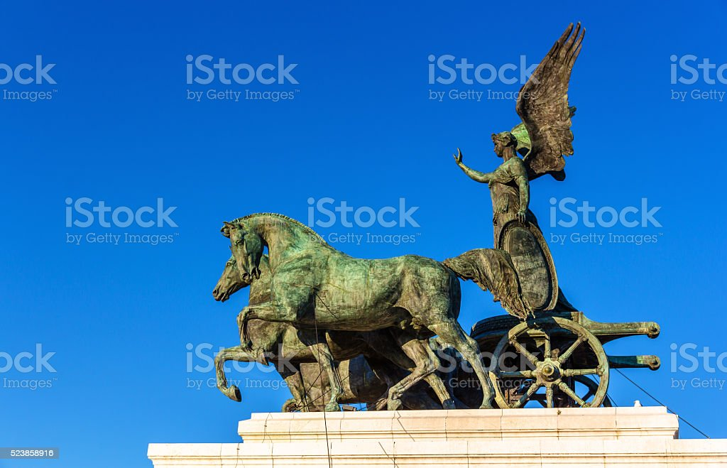 Statue of goddess Victoria on Vittorio Emanuele II Monument in stock photo