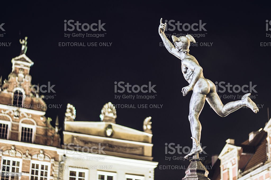 Statue of Hermes in Old Town of Gdansk by night stock photo