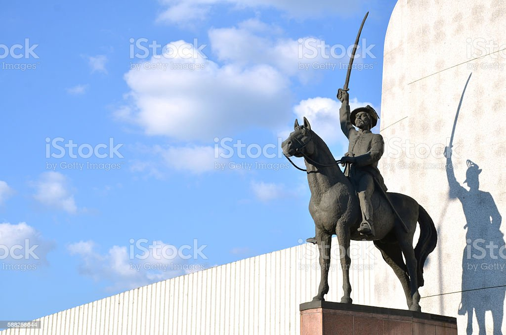 Statue of hero displayed like fighter with sword on horse stock photo
