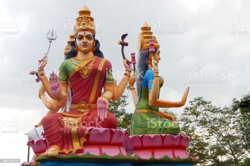 Statue of Hindu goddess Durga along with lakshmi and sararaswati as in mythology in a temple exteriors, Kotappa konda,AP,India. stock photo