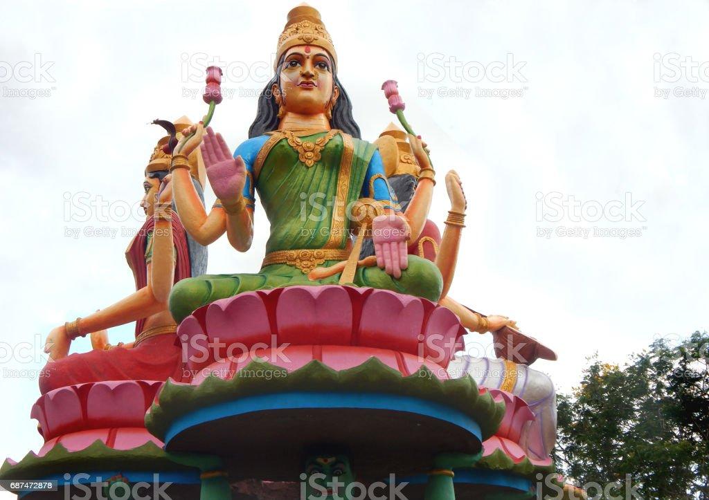 Statue of Hindu goddess sararaswati along with lakshmi and Durga as in mythology in temple exteriors, Kotappa konda,AP,India. stock photo