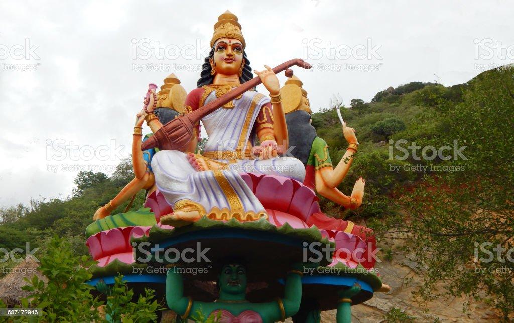Statue of Hindu goddess sararaswati along with lakshmi and Durga as in mythology in a temple exteriors, Kotappa konda,AP,India. stock photo