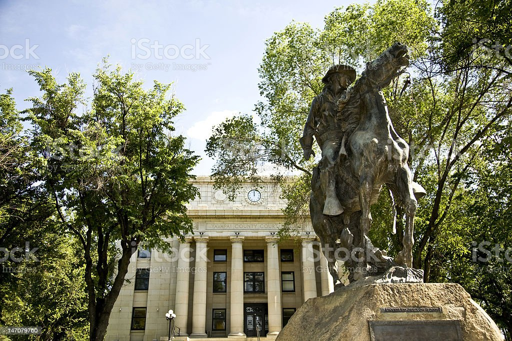 Statue of horseman in front of Yavapai County Courthouse stock photo
