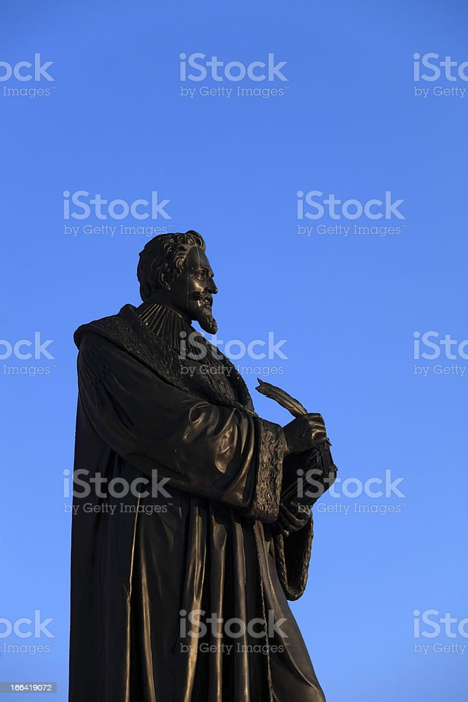 statue of Hugo Grotius (1583-1645) against a clear blue sky royalty-free stock photo