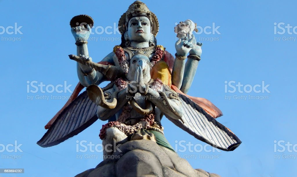 Statue of Indian Hindu god Vishnu on garuda on temple top stock photo
