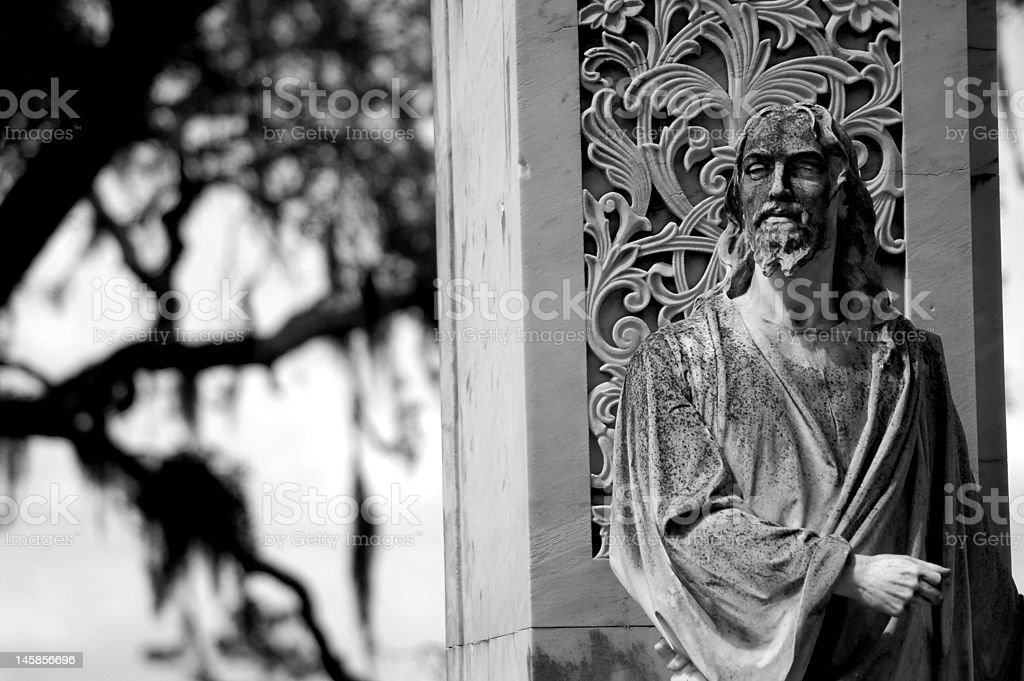 Statue of Jesus Christ in Cemetery stock photo