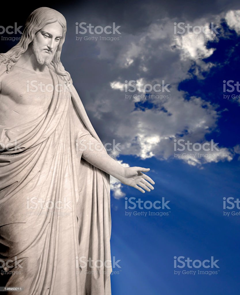 A statue of Jesus on a cloudy day royalty-free stock photo
