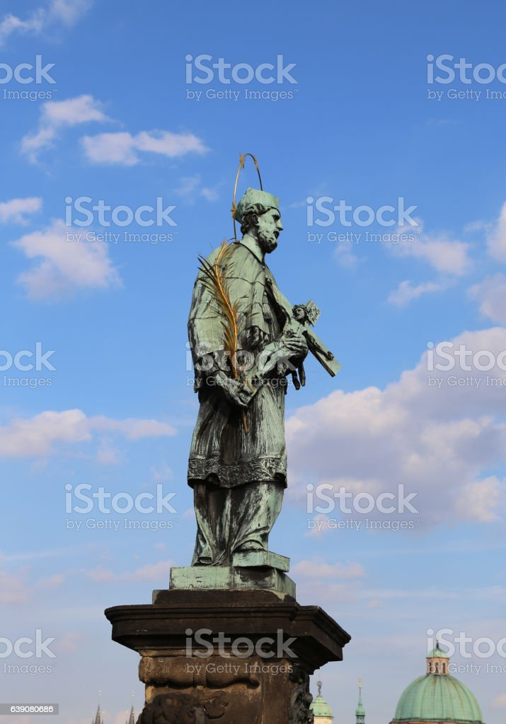statue of John of Nepomuk at Charles Bridge in Prague stock photo