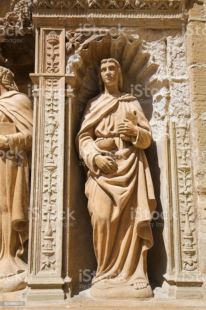 Statue of John the Apostle at the Saint Thomas Church stock photo