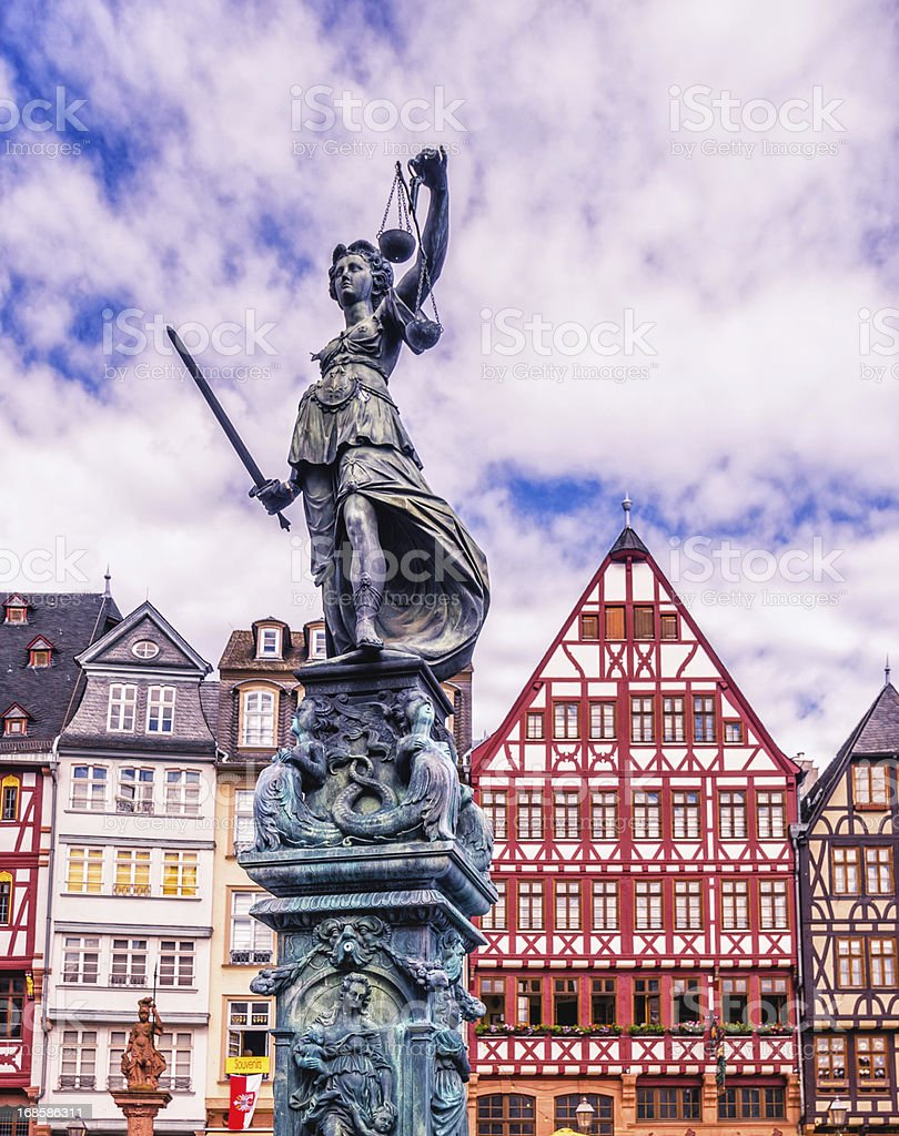 Statue of Justice and Frankfurt Römer stock photo