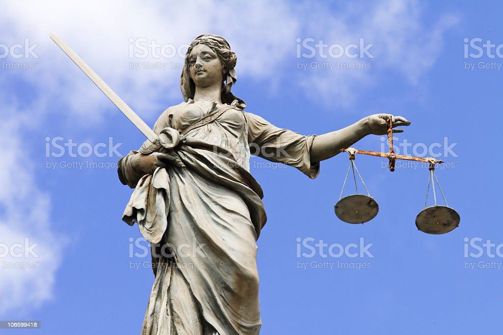 Statue of Justitia holding the Scales of Justice stock photo