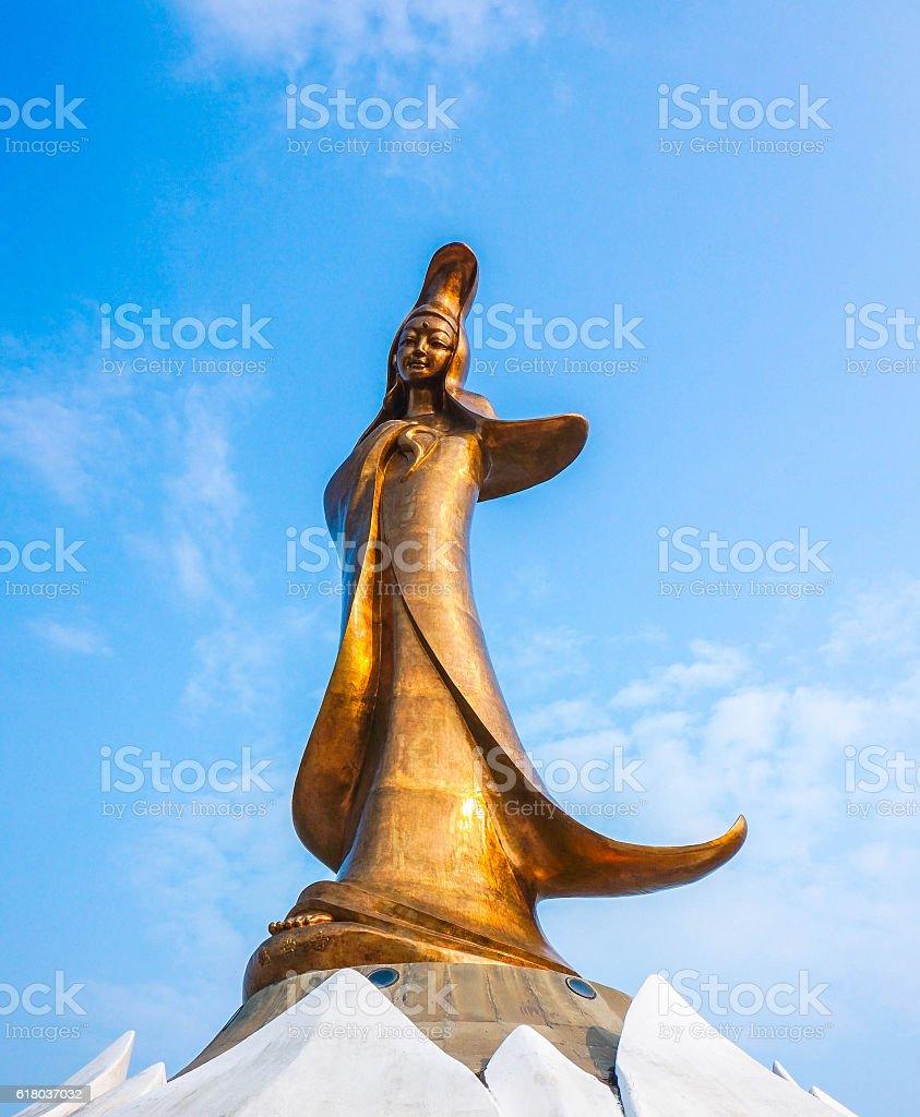 statue of Kun Iam against blue sky in macau. stock photo
