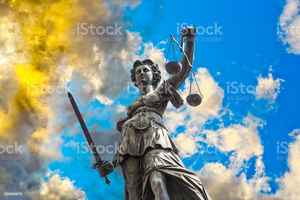 Statue of Lady Justice in front of the Romer stock photo