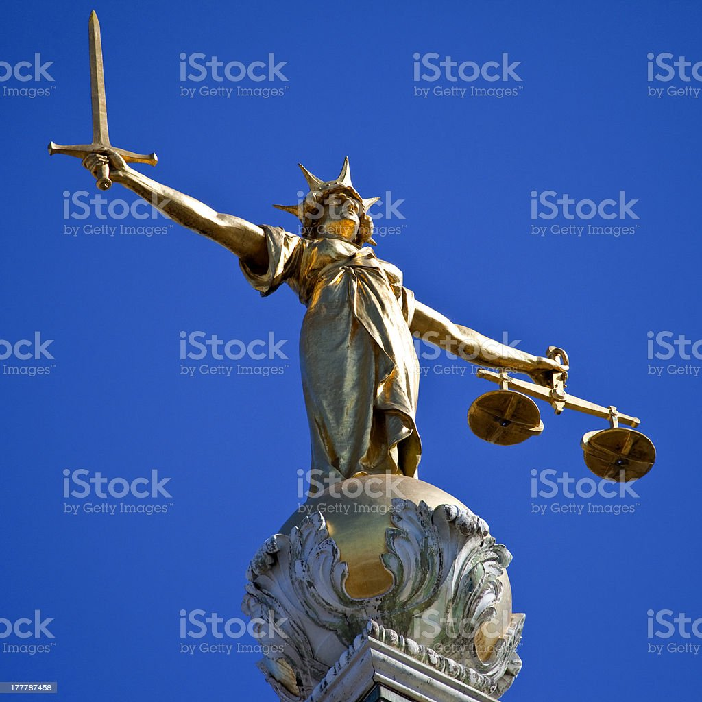 Statue of Lady Justice on top of Old Bailey in London royalty-free stock photo
