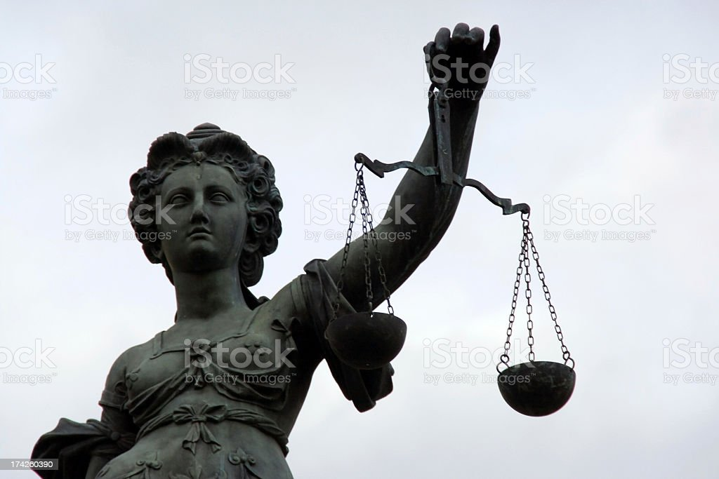 Statue of Lady Justitia at the law courts stock photo