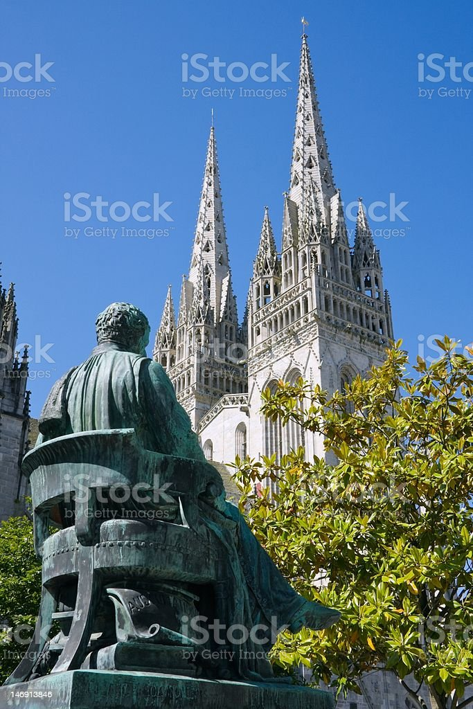 Statue of  Laënnec and  cathedral St Corentin ( France) stock photo
