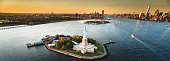 statue of liberty aerial view with manhattan on the background