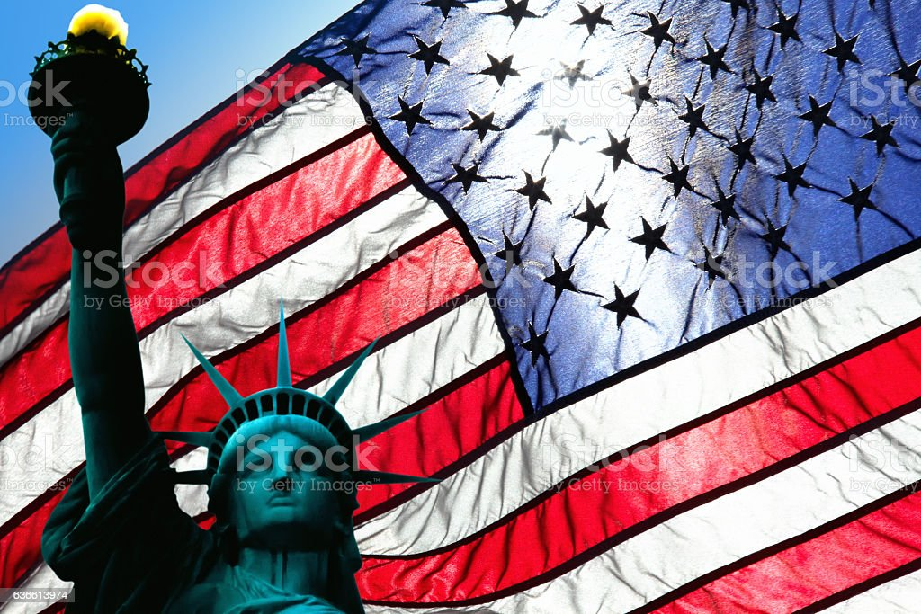 statue of liberty and american flag stock photo