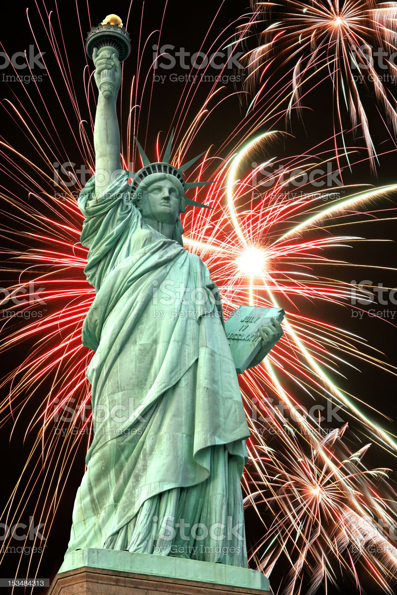 Statue of Liberty and fireworks in black sky royalty-free stock photo