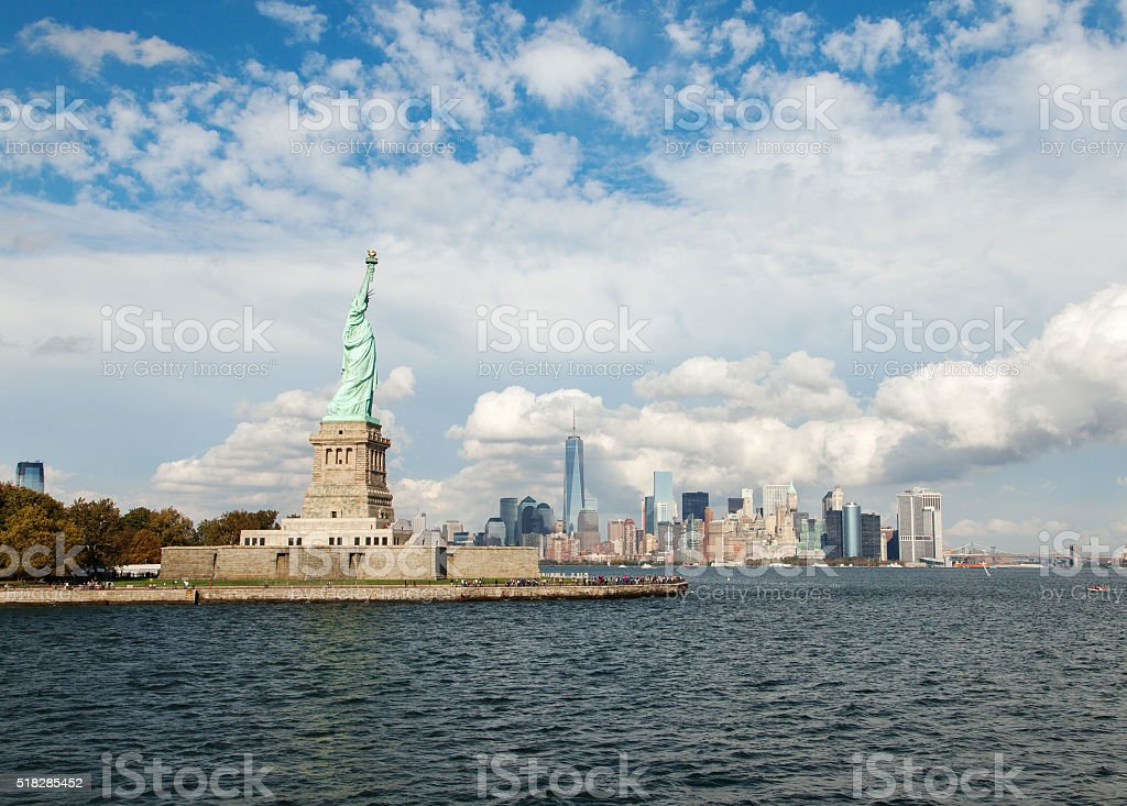 Statue of Liberty and Manhattan Buildings stock photo