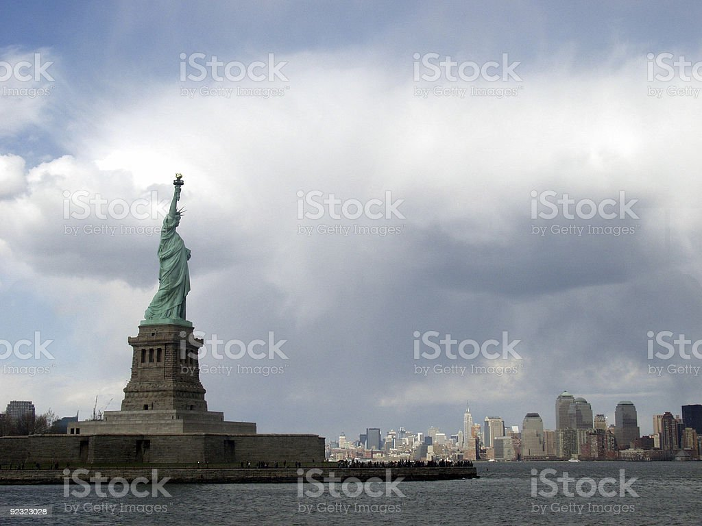 Statue of Liberty and Manhattan royalty-free stock photo