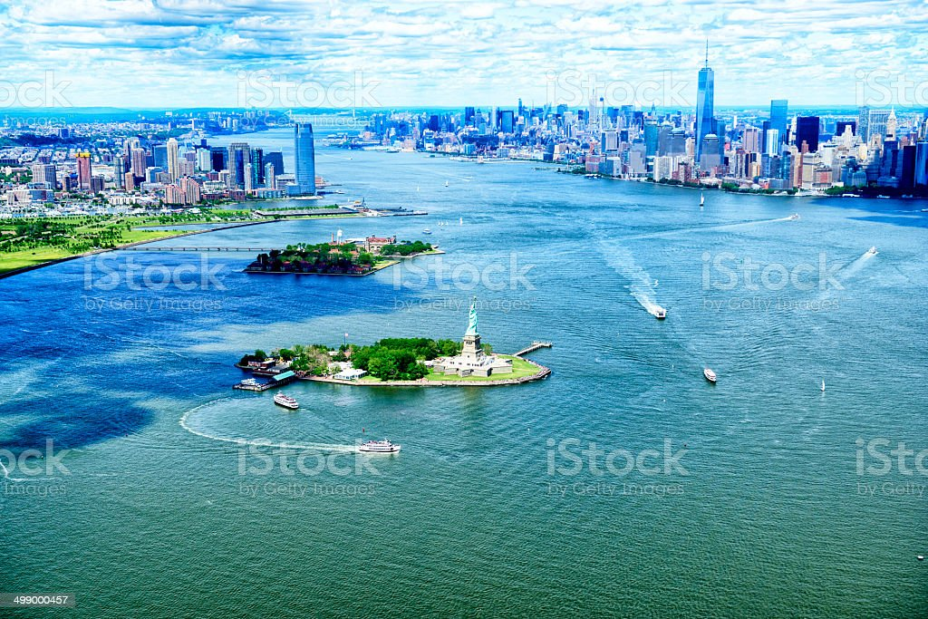 Statue of Liberty and Manhattan Skyline, NYC. Aerial View. stock photo