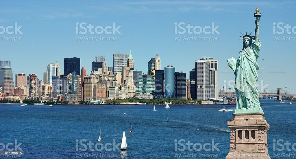 Statue of Liberty and New York City skyline royalty-free stock photo