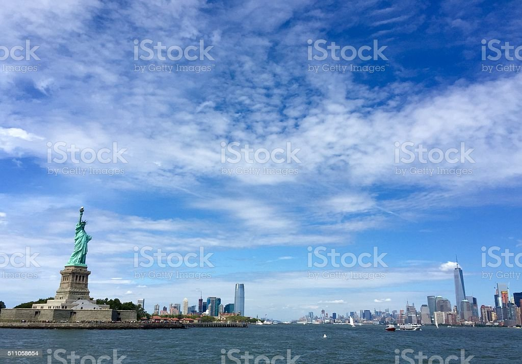 Statue of Liberty and the city with blue sky stock photo