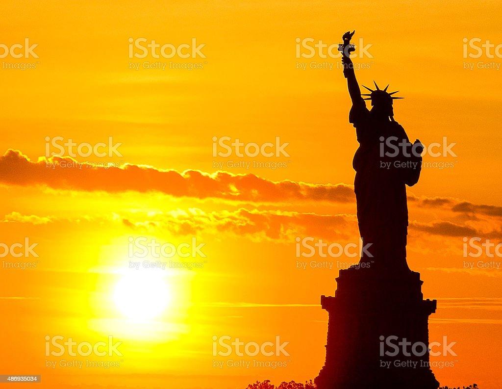 Statue of Liberty at sun set stock photo