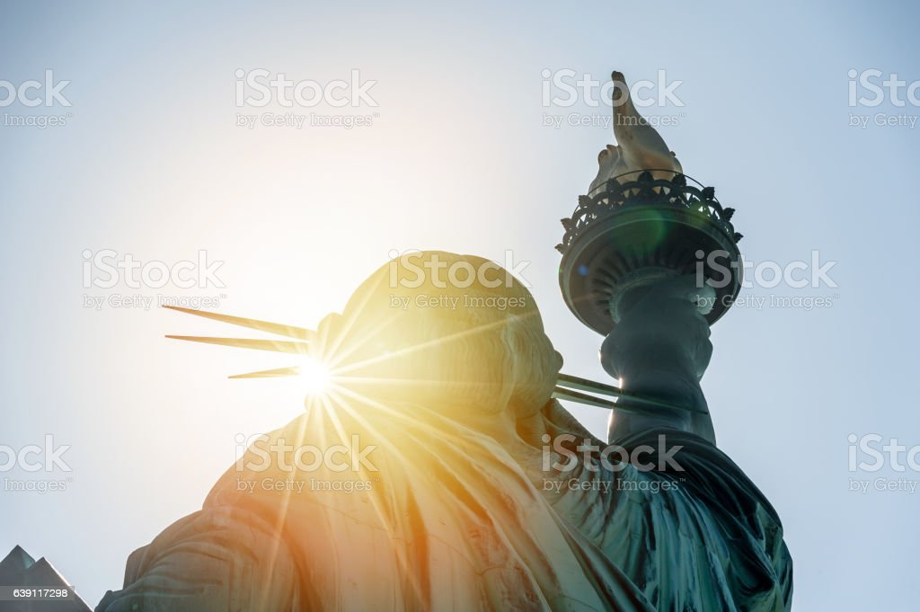 Statue of liberty at sunset stock photo