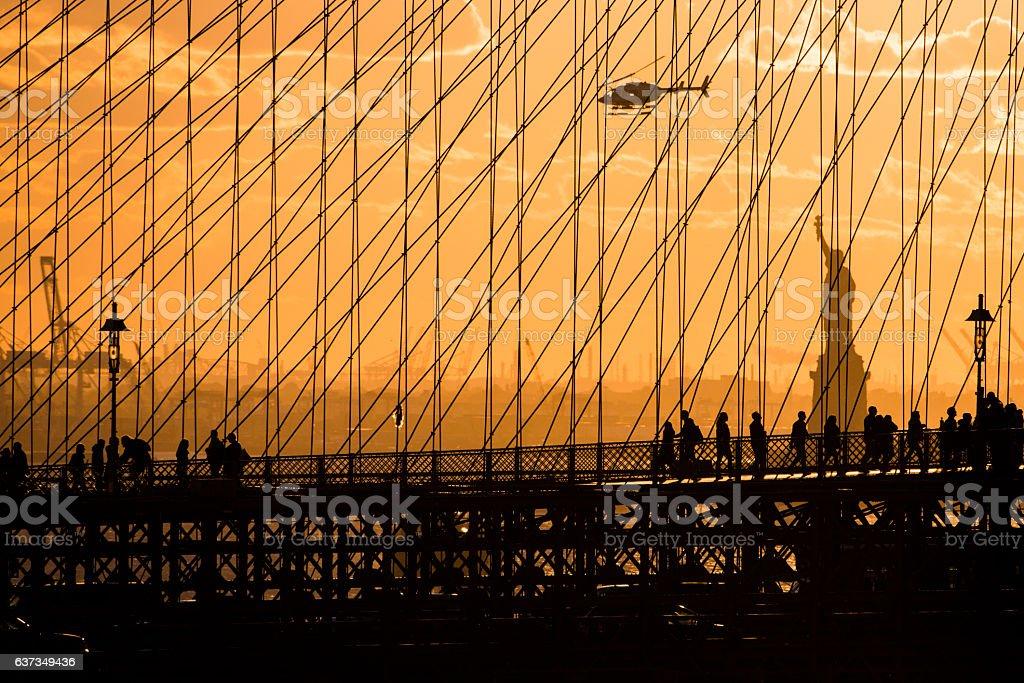 Statue of Liberty Brooklyn Bridge Sunset stock photo