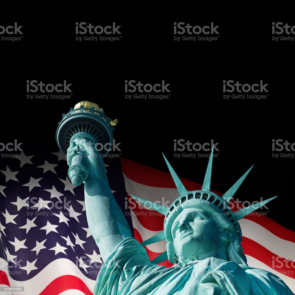Statue Of Liberty Infront Of American Flag stock photo