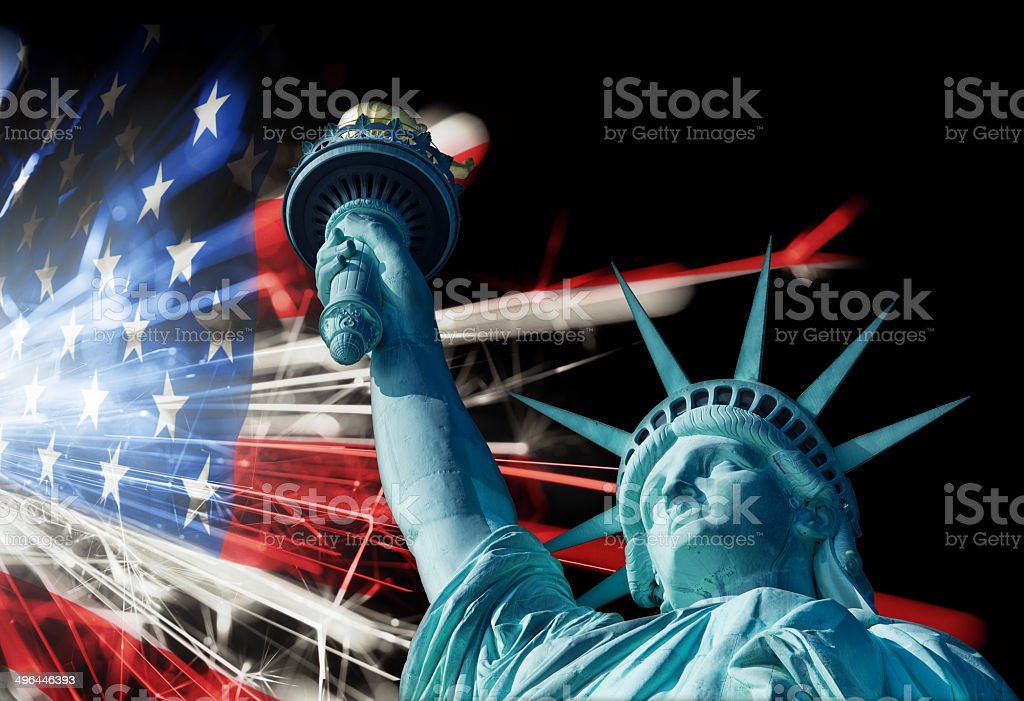 Statue Of Liberty Infront Of Sparkling American Flag stock photo