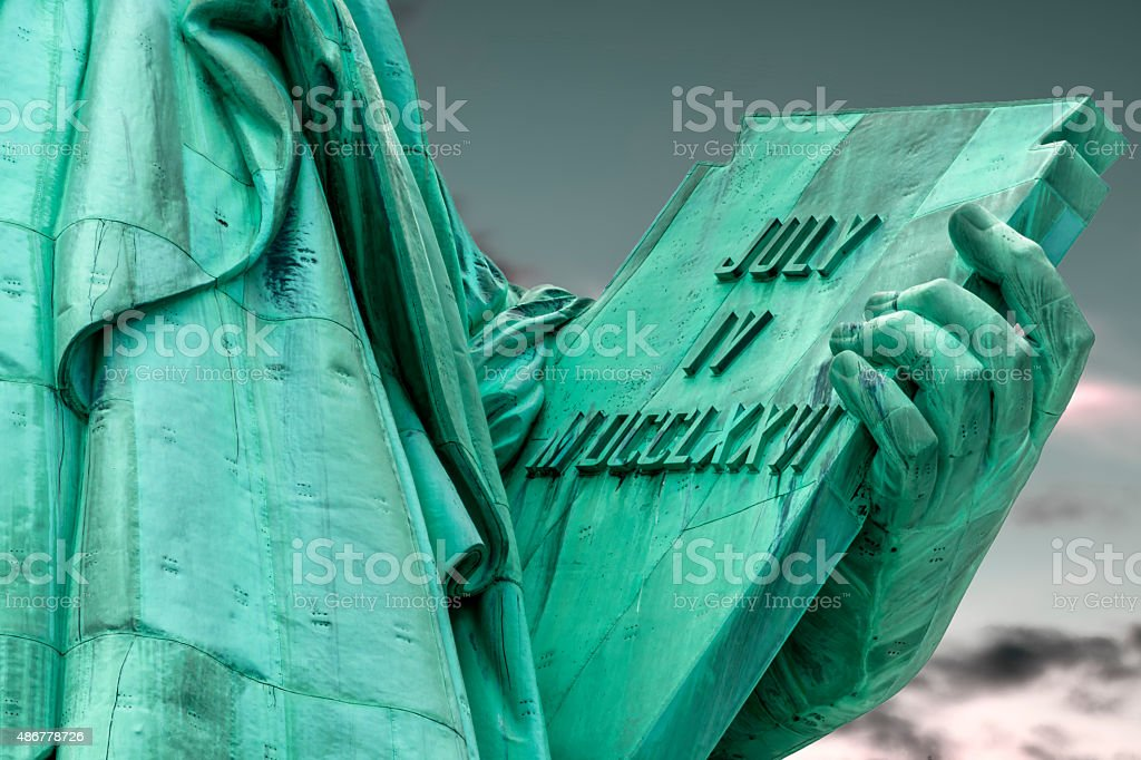 Statue of liberty is holding a tablet stock photo