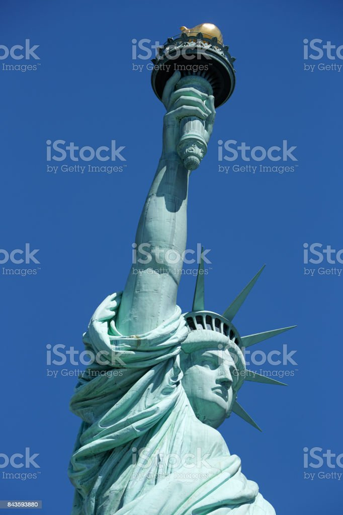 Statue of Liberty lateral view detail, blue sky in New York stock photo