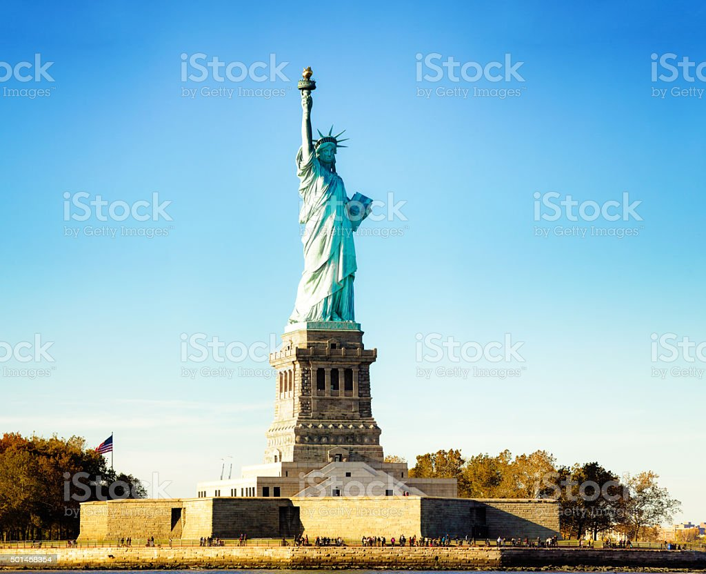 Statue of liberty near sunset blue sky extra large stock photo