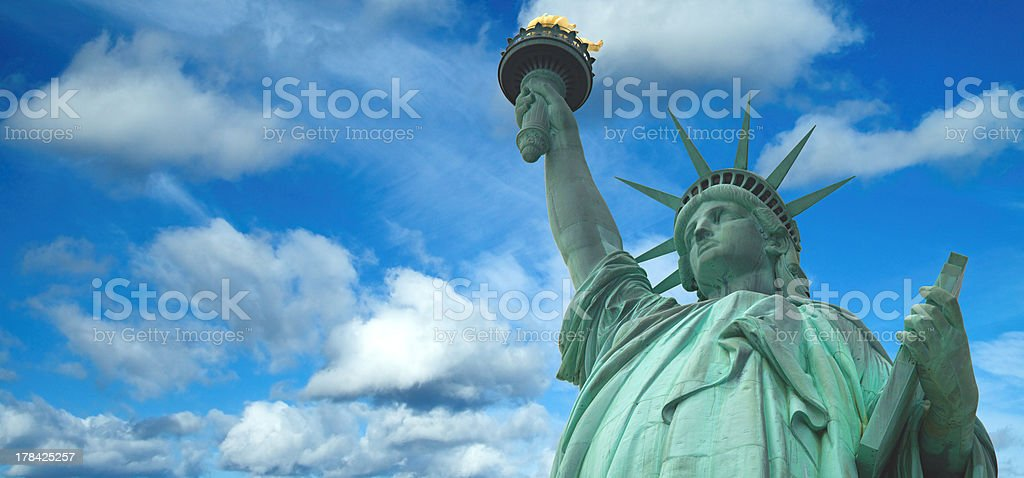 Statue of Liberty panorama with bright blue sky, New York stock photo