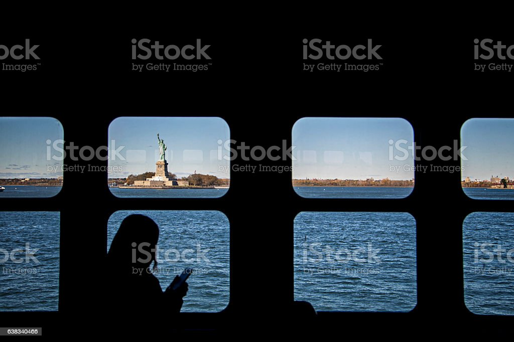 Statue of Liberty seen through ferry window stock photo