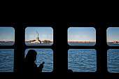 Statue of Liberty seen through ferry window