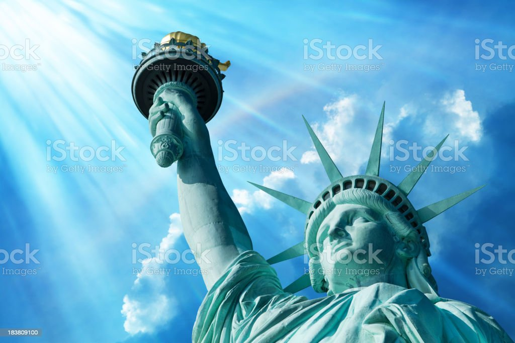 Statue Of Liberty Under Blue Sky With Rainbow royalty-free stock photo
