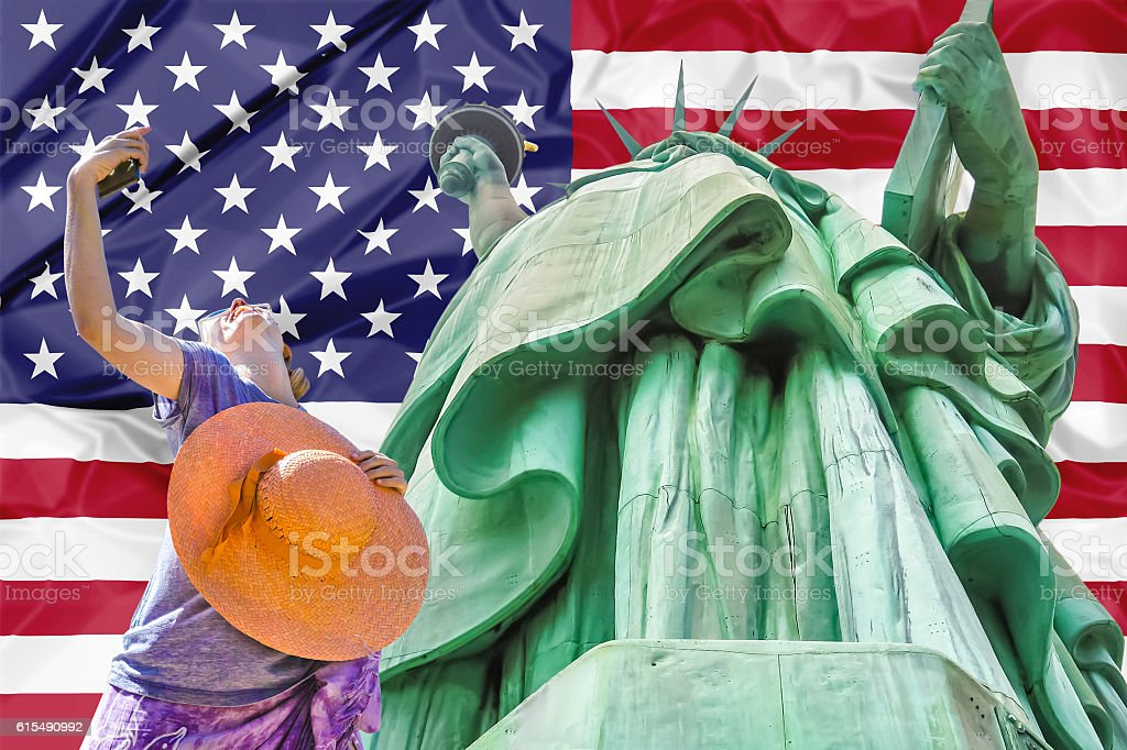 Statue of Liberty with american flag stock photo