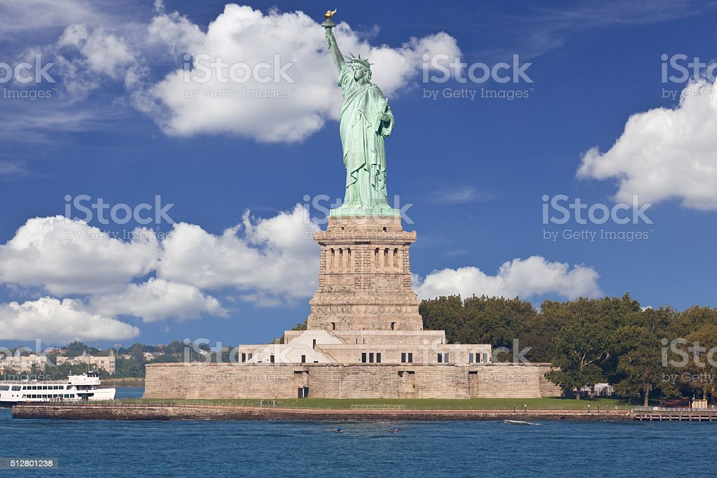 Statue of Liberty with Blue Sky and Clouds, New York. stock photo