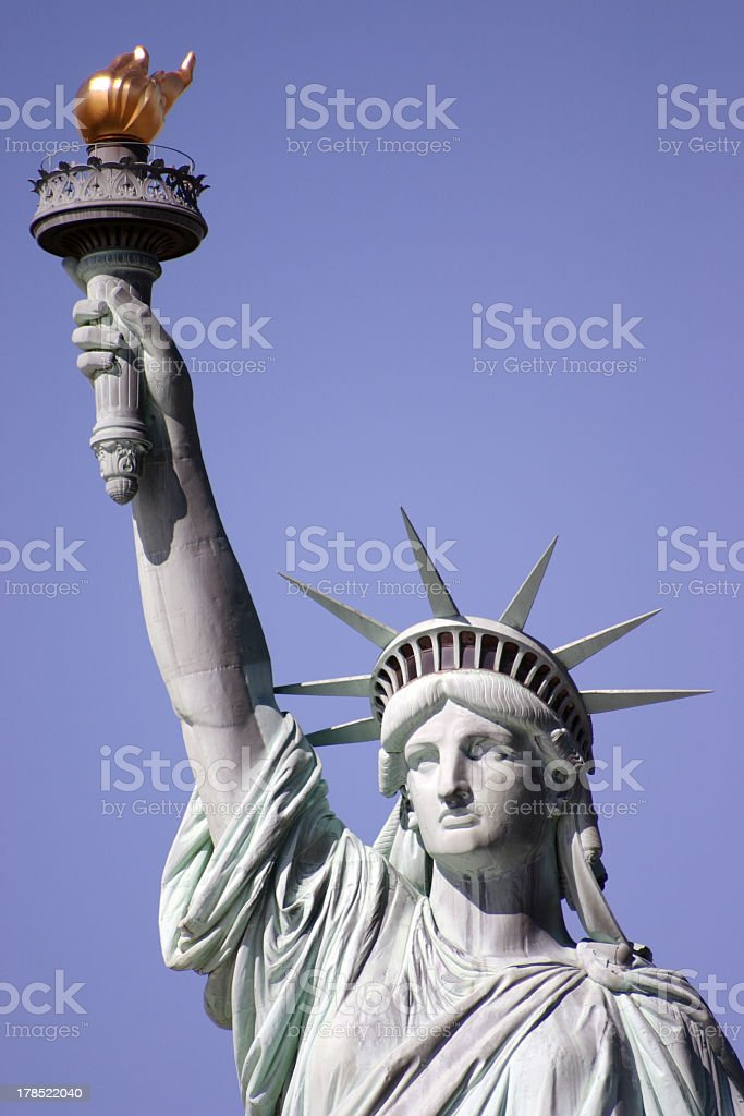 Statue of Liberty with cloudless blue sky background  royalty-free stock photo