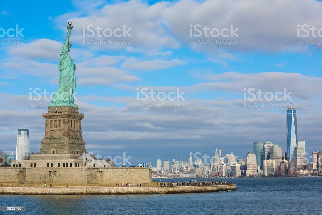 Statue of Liberty with downtown Manhattan stock photo