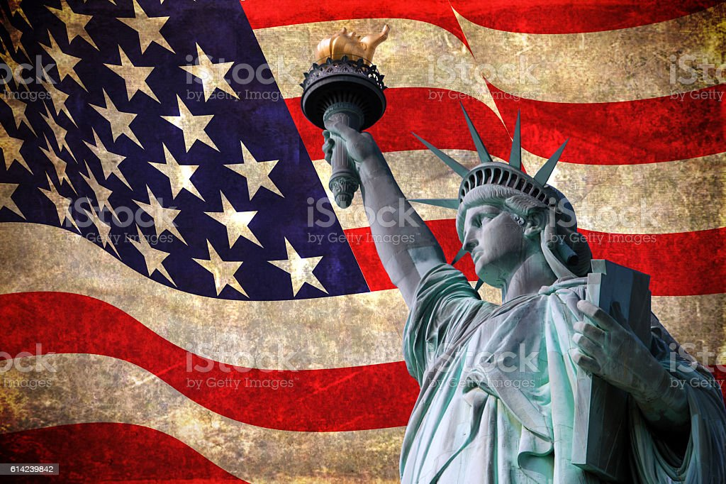 Statue of Liberty with flag of the United States of America stock photo