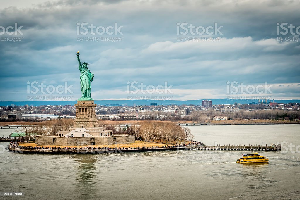 Statue of Liberty with Jersey City in the background stock photo