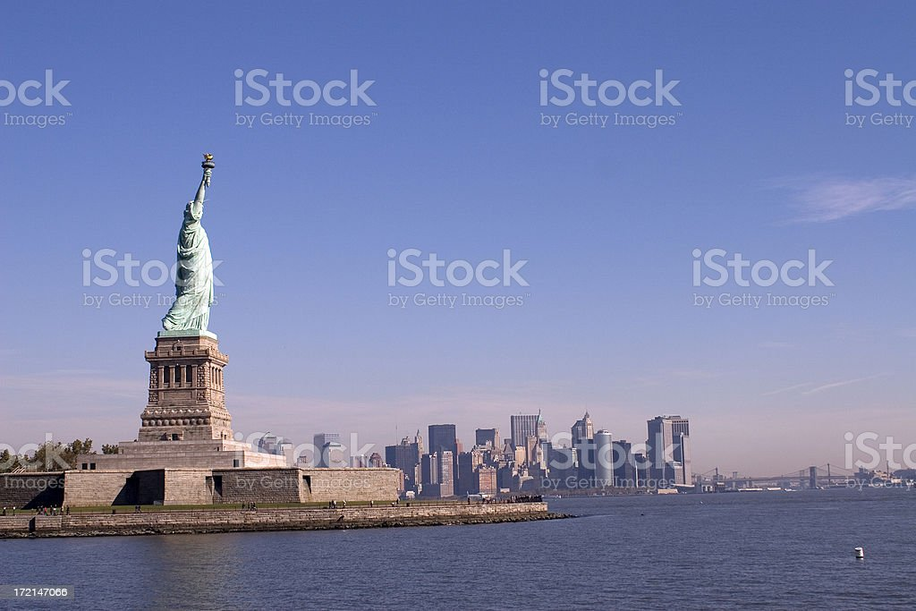 Statue of Liberty with New York stock photo