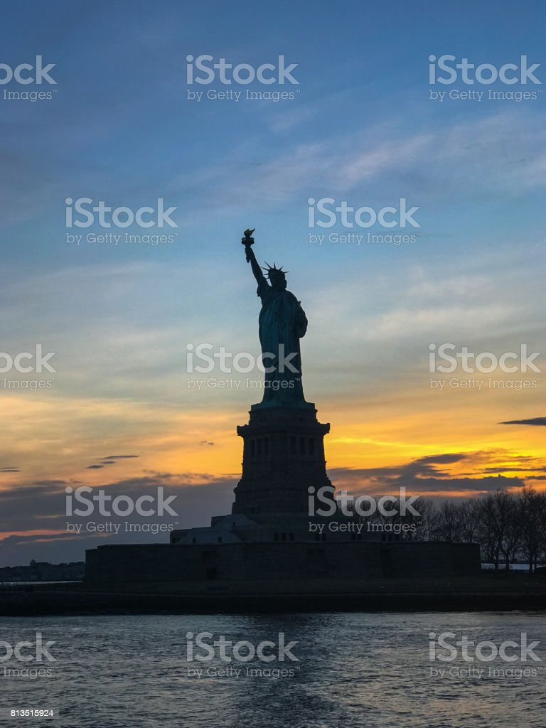 Statue of Liberty with Sunset Behind stock photo