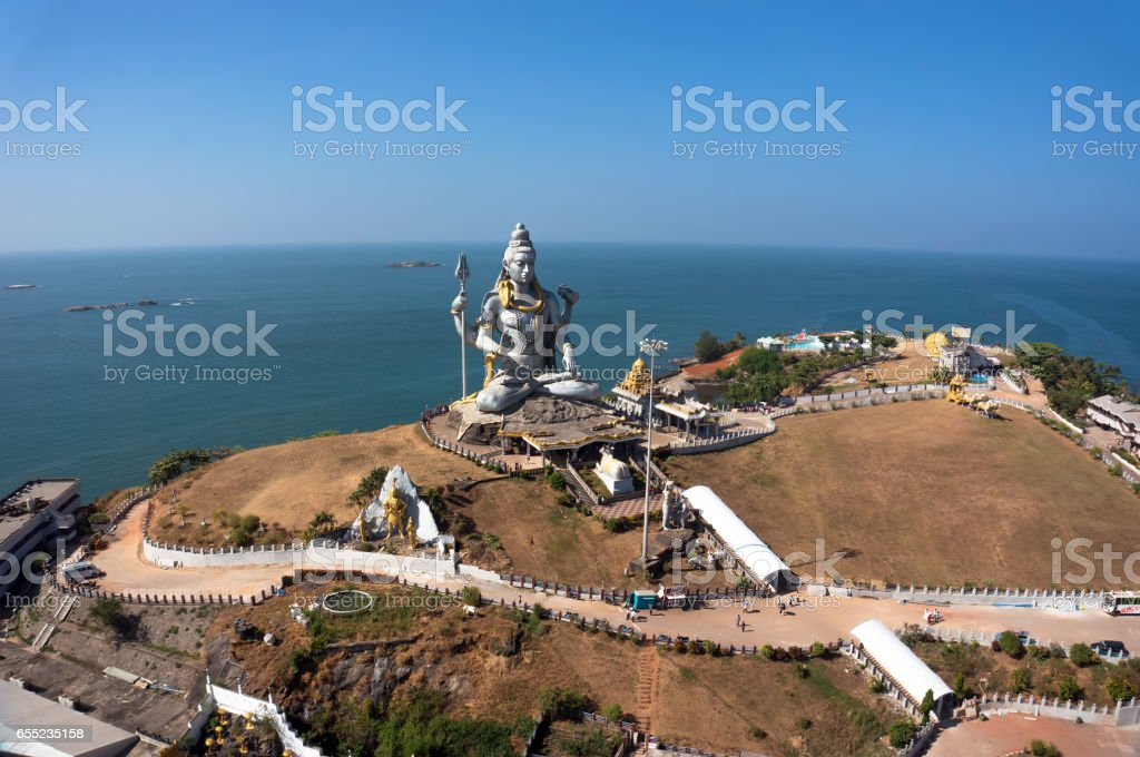 Statue of Lord Shiva was built at Murudeshwar temple on the top of hillock which overlooks the Arabian Sea stock photo